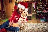 Girl with dog taking Christmas selfie