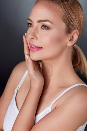 Gentle woman with perfect fresh skin