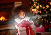 girl opening Christmas magic present