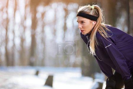 Sportswoman resting from running