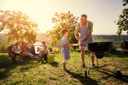 family picnic with barbecue