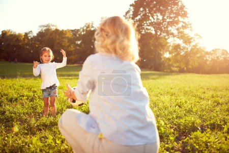 Photo for Lovely child with mother spend time in sunny park - Royalty Free Image