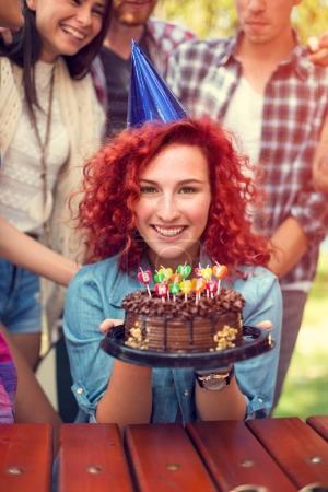 Portrait of birthday girl holding nice chocolate c...