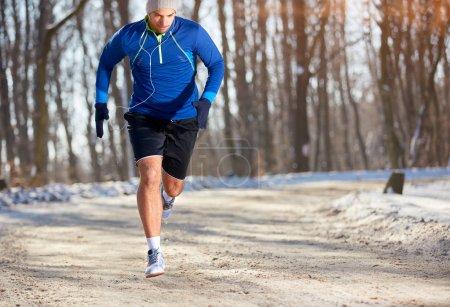 Sprinter running in nature