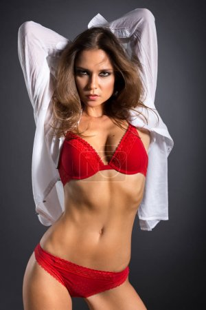 Photo for Attractive young girl in red lingerie - Royalty Free Image