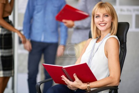 Photo for Young businesswoman sitting and working in store - Royalty Free Image