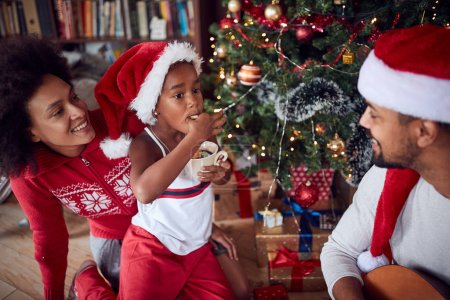Photo for Happy young family with girl and Christmas gifts on floor at home - Royalty Free Image