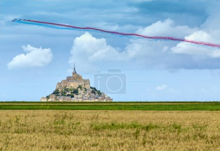 Festive flight above Mont Saint Michel Monastery