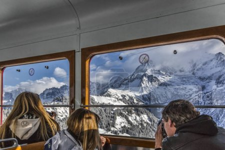 Tourists in the Tramway in Mountains