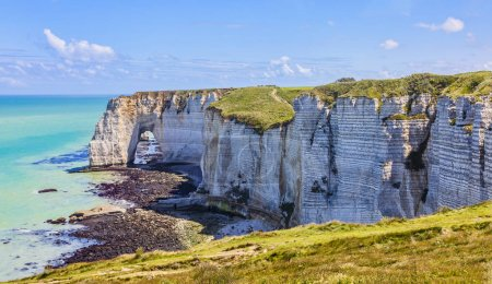 "Low tide landscape featuring the ""The Manneporte"" natural stone arch, closed to Etretat in Normandy, France."