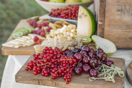 Photo for Cheese and fruits on a beautifully vintage decorated table - Royalty Free Image