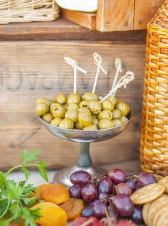 Photo for Olives on a beautifully vintage decorated table - Royalty Free Image