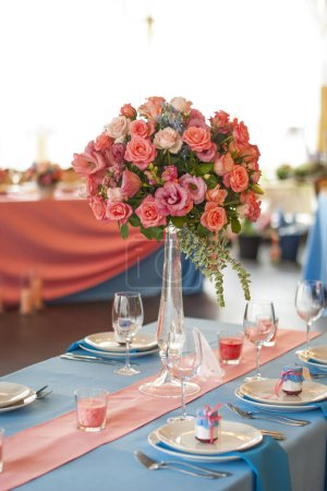 Photo for Table set for an event party flowers decorated - Royalty Free Image