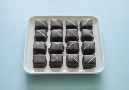 Photo for Chocolate candies in a white plate - Royalty Free Image