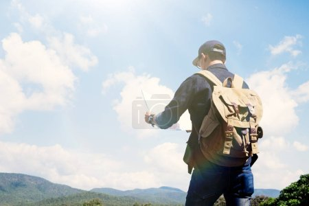 Young Man Traveler with backpack relaxing outdoor....