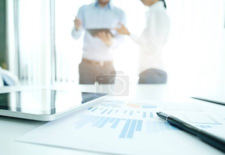 Photo for Close-up of business plan with people working in the background - Royalty Free Image