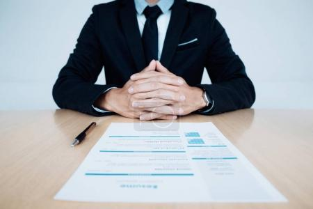 Photo for Business Job interview. HR and resume of applicant on table - Royalty Free Image