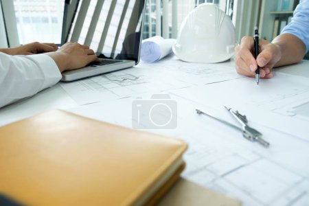 Photo for Image of engineer meeting for architectural project. working with partner and engineering tools on workplace vintage tone. - Royalty Free Image