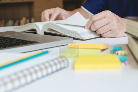 Photo for Man reading a book. Education, Academic, Learning and Exam concept. - Royalty Free Image
