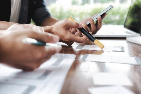 Photo for Web designer, UX UI designer planning application for mobile phone. - Royalty Free Image