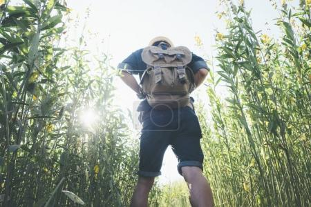 Photo for Relax adventure and lifestyle hiking travel idea concept. Young Man Traveler with backpack relaxing outdoor - Royalty Free Image