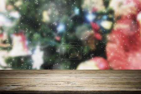 Photo for Wood table top on Christmas decorataion tree background used for montage or display the products - Royalty Free Image