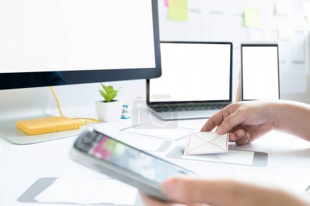 Photo for Web designer, UX UI designer planning application for mobile phone. Responsive web desingn and mobile application design. - Royalty Free Image