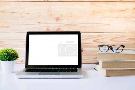 Photo for Mock up blank white screen laptop. Working space and white screen laptop. - Royalty Free Image