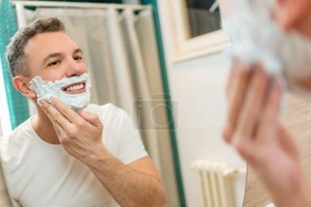 Smiling man Shaving