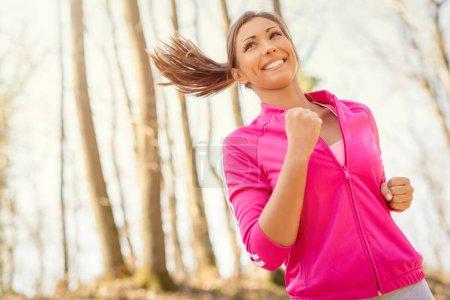 beautiful woman running in nature