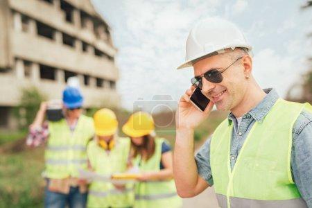 Construction architect using phone