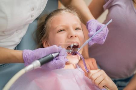 girl visit dentist office
