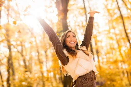 woman having fun in sunny forest