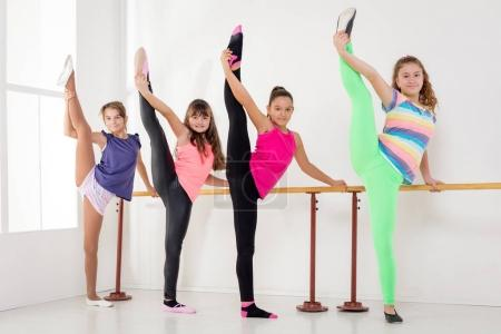 young  girls using barre