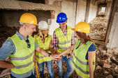 Four construction architects