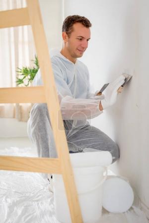 Man polishing Wall