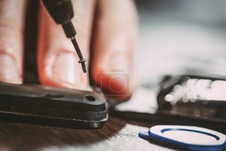Man Repairing A Mobile phone