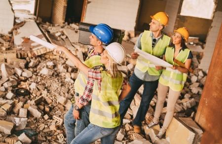 woman architect pointing at object in building