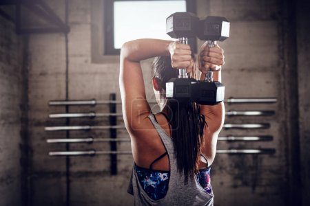 Woman doing exercise for triceps