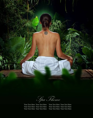 View of nice young woman meditating in spa environment