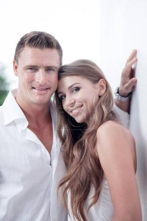 portrait of nice young couple on white wall background