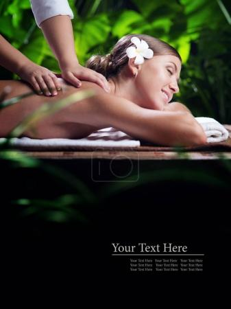 portrait of young beautiful woman in spa environment.  banner, space for rext.
