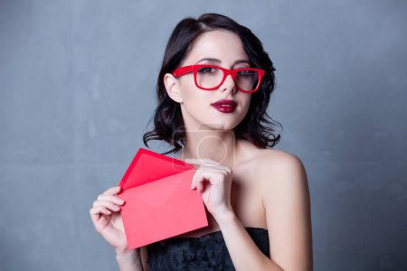 woman in black dress with envelope