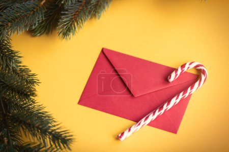 Red christmas envelope and lolipop