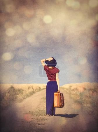 woman with suitcase standing