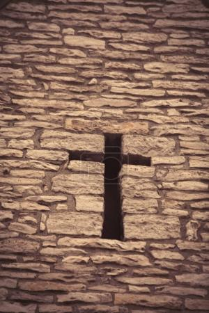 beautiful cross in stone bricks wall