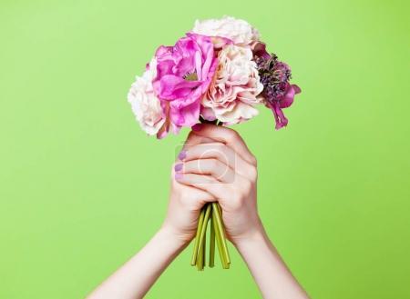 female hands holding flowers