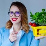 Постер, плакат: Woman in coat with herbs