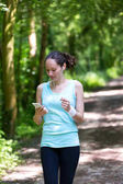 attractive woman running in the forest