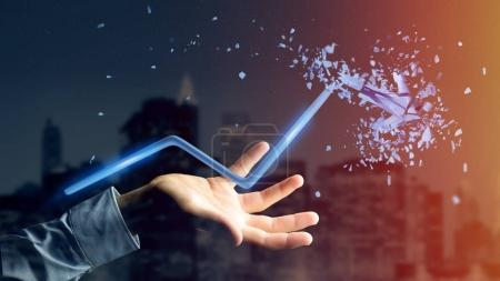 View of a Businessman holding a Financial arrow going up and explosing at the end - 3d rendering